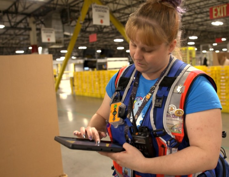 amazon's hand-held device in warehouse, source:https://blog.aboutamazon.com/operations/5-things-you-dont-know-about-safety-in-amazon-warehouses